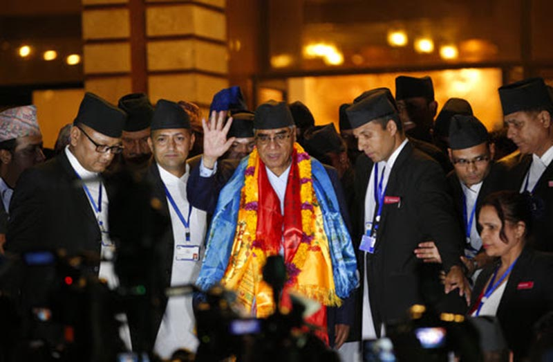 Nepal's newly elected prime minister Sher Bahadur Deuba, center, waves to the media at the Parliament House in Kathmandu, Nepal, Tuesday, June 6, 2017.  Nepal's parliament has elected the veteran politician as the country's 10th prime minister in 11 years. It is the fourth time that Deuba has been prime minister of the Himalayan nation. Photo: AP