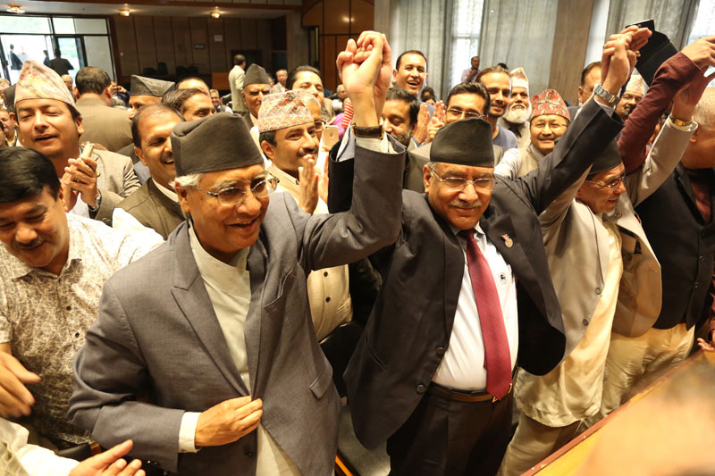 Nepali Congress President Sher Bahadur Deuba (left),  along with the outgoing Prime Minister Pushpa Kamal Dahal among other seconders cheer after filing Deuba's nomination for the post of Prime Minister, at the Legislature-Parliament Secretariat, in Kathmandu, on Saturday, June 3, 2017. Photo: RSS