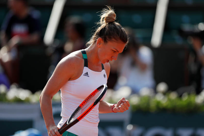 Romania's Simona Halep reacts during her semi final match against Czech Republic's Karolina Pliskova. Photo: Reuters