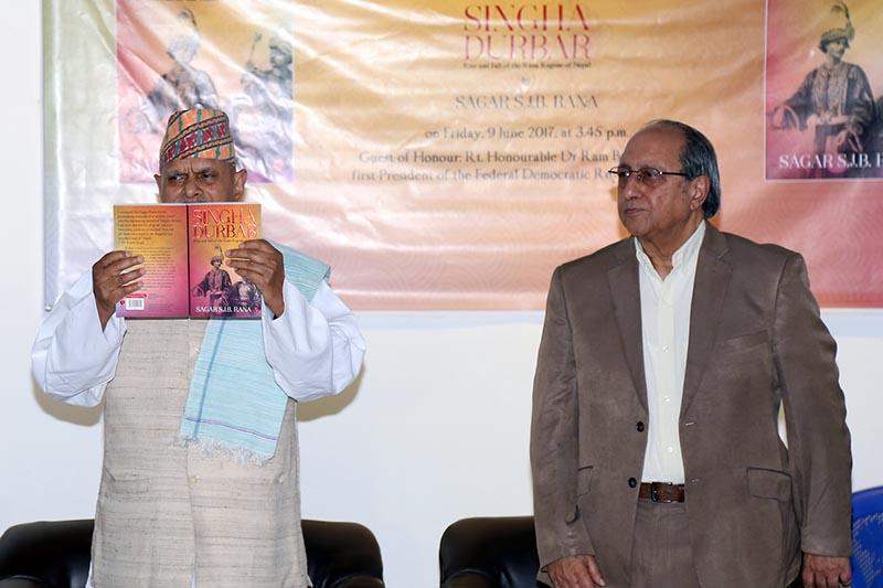 Former President Dr Ram Baran Yadav (left) releases a book 'Singha Durbar' by the author Sagar Shumsher JB Rana amid a programme, in Kathmandu, on Friday, June 9, 2017. Photo: RSS