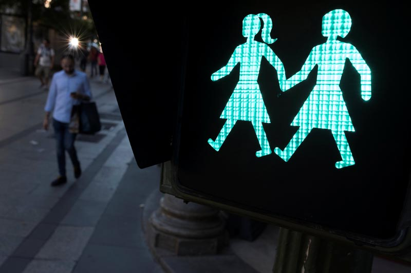 A same sex couple traffic light signal, erected ahead of WorldPride Madrid 2017, is seen in Madrid, Spain, on June 6, 2017. Photo: Reuters