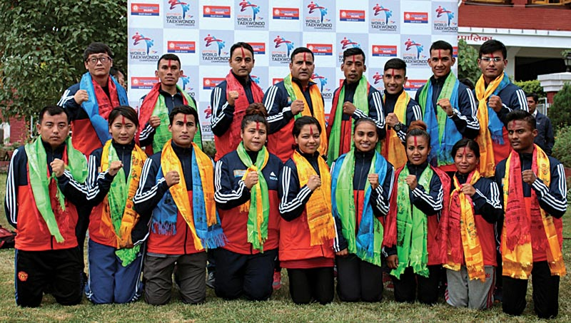Nepali taekwondo players and officials pose for a group photo after a farewell programme in Lalitpur, on Tuesday. Photo: THT