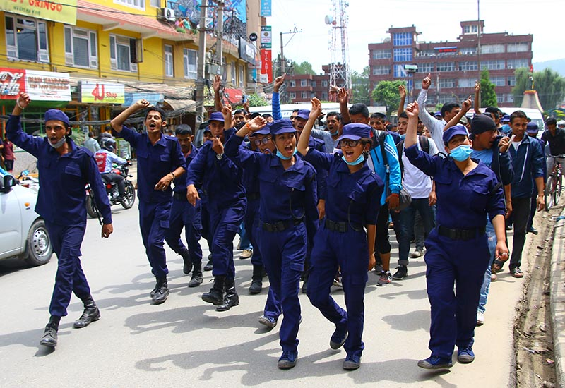 Temporary police personnel staging a demonstration demanding payment of promised remuneration, in Jawlakhel, Lalitpur, on Tuesday, June 6, 2017. Photo: THT