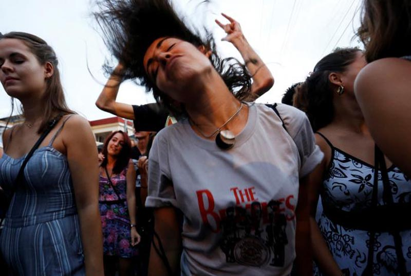 A woman dances during an open-air covers concert in celebration of the release of Beatles' landmark album 'Sgt. Pepper's Lonely Hearts Club Band' 50 years ago, in Havana, Cuba, on June 1, 2017. Photo: Reuters