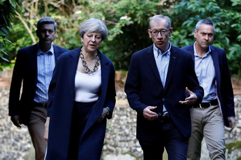 Britain's Prime Minister Theresa May and her husband Phillip arrive at church in Sonning, Britain on June 11, 2017. Photo: Reuters