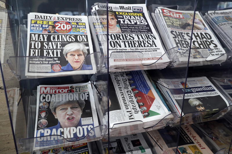 Newspapers fronted with photos of British Prime Minister Theresa May and others are displayed at a shop in Westminster in London, Saturday June 10, 2017. Photo: AP