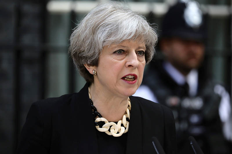 Britain's Prime Minister Theresa May speaks outside 10 Downing Street after an attack on London Bridge and Borough Market left 7 people dead and dozens injured in London, Britain, June 4, 2017. Photo: Reuters