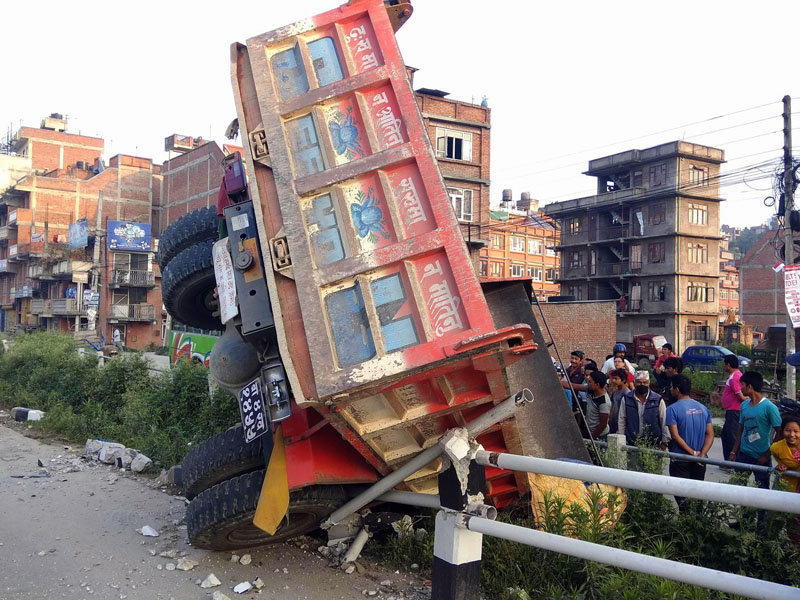 A tipper (Ba 4 Pa 1455) jolting over the traffic barriers along the Araniko Highway in Thimi of Bhaktapur district on Thursday, June 01, 2017. The tipper was heading towards Bhaktapur from Kathmandu when it met with the accident.