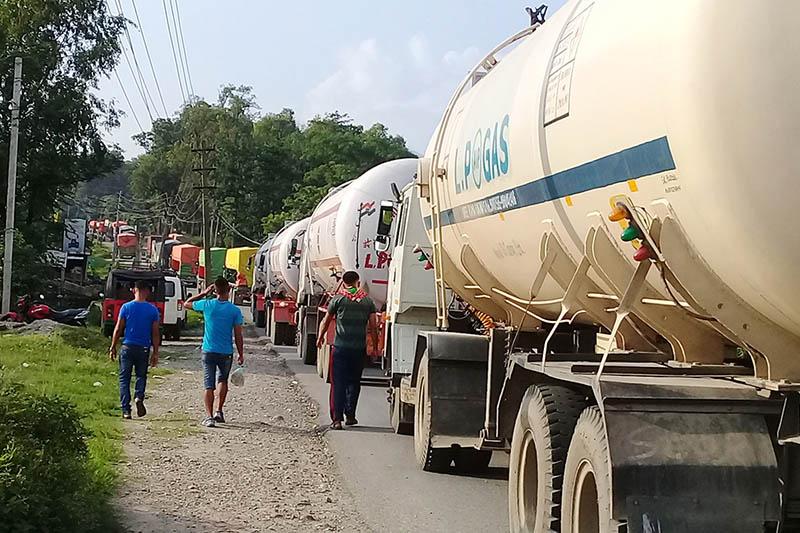 Vehicles are seen stranded at Aaptari along the Muglin-Narayangard road section after landslide at Kalikhola obstracted the highway, on Friday, June 23, 2017. Photo: RSS