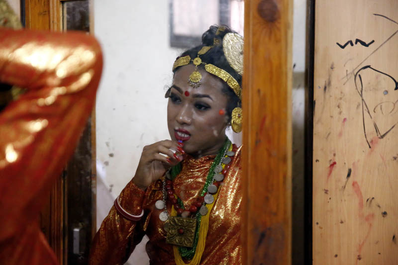 A Nepali transgender dressed in traditional attire getting ready in front of mirror , before a dance competition, organised by the Blue Diamond Society, in Kathmandu, on Sunday, June 25, 2017. Photo: Skanda Gautam