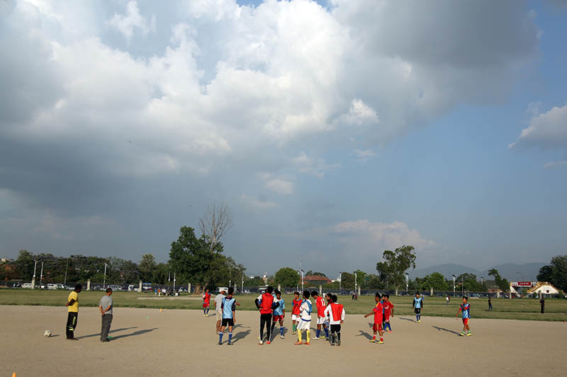 FILE - Youths gather around to listen to coach instruction before a practice session in Tundikhel, Kathmandu, on Friday, June 2, 2017. Photo: RSS