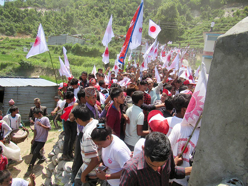 CPN-UML cadres chant slogans on their way to file nomination at the Election Office in Chededaha Rural Municipality of Bajura  district, on Sunday, June 18, 2017. Photo: Prakash Singh