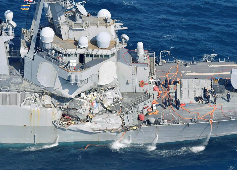 The Arleigh Burke-class guided-missile destroyer USS Fitzgerald, damaged by colliding with a Philippine-flagged merchant vessel, is seen off Shimoda, Japan, on June 17, 2017. Photo: Kyodo/via Reuters