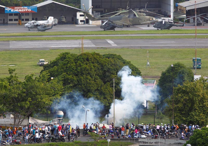 Riot security forces fire tear gas at opposition supporters from an air force base during clashes at a rally against Venezuelan President Nicolas Maduro's government in Caracas, Venezuela, on June 22, 2017. Photo: Reuters
