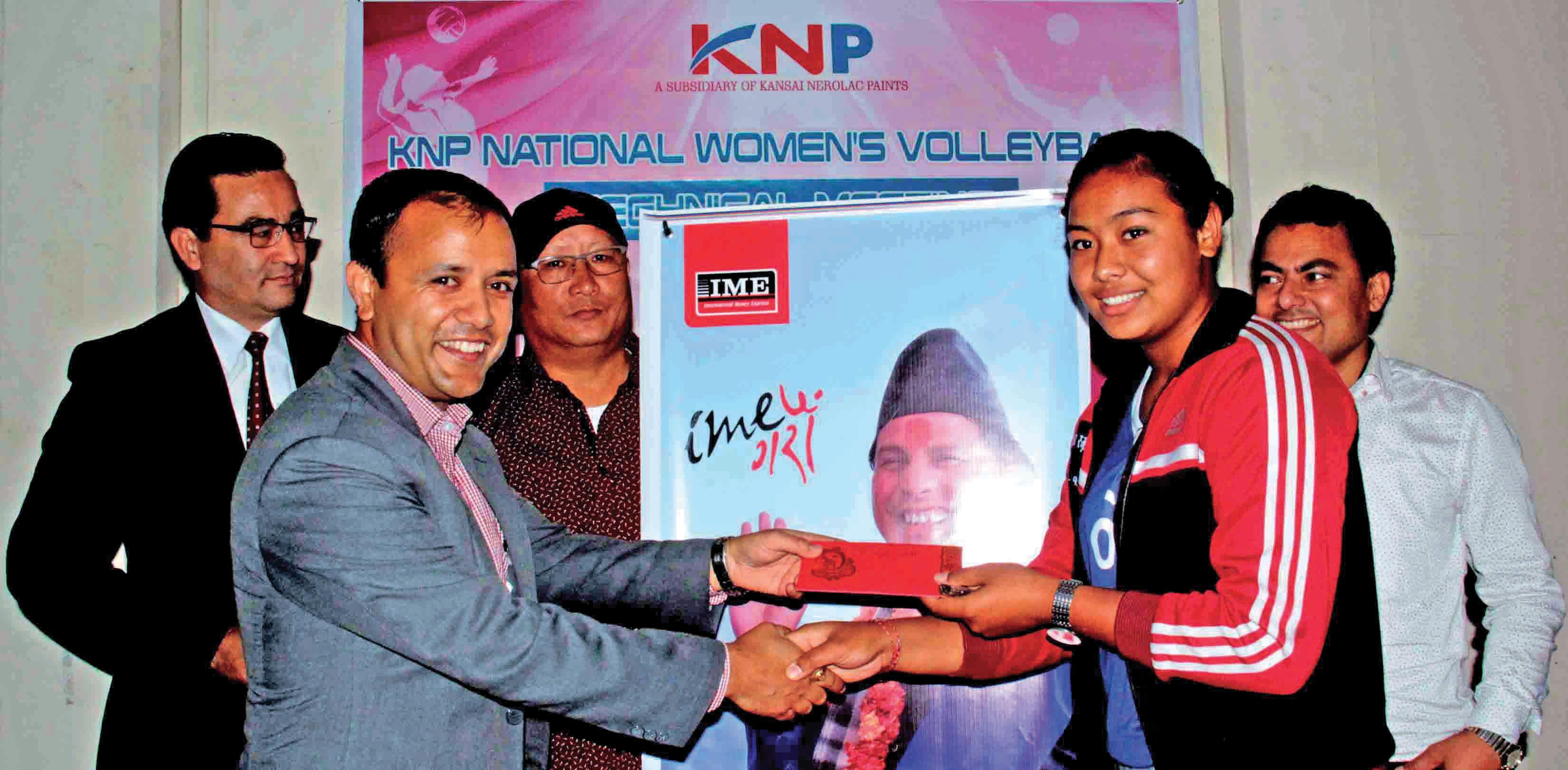 CEO of IME Remit Suman Pokhrel handing over the scholarship amount to volleyball player nPratibha Mali in Kathmandu, on Monday. Photo: THT