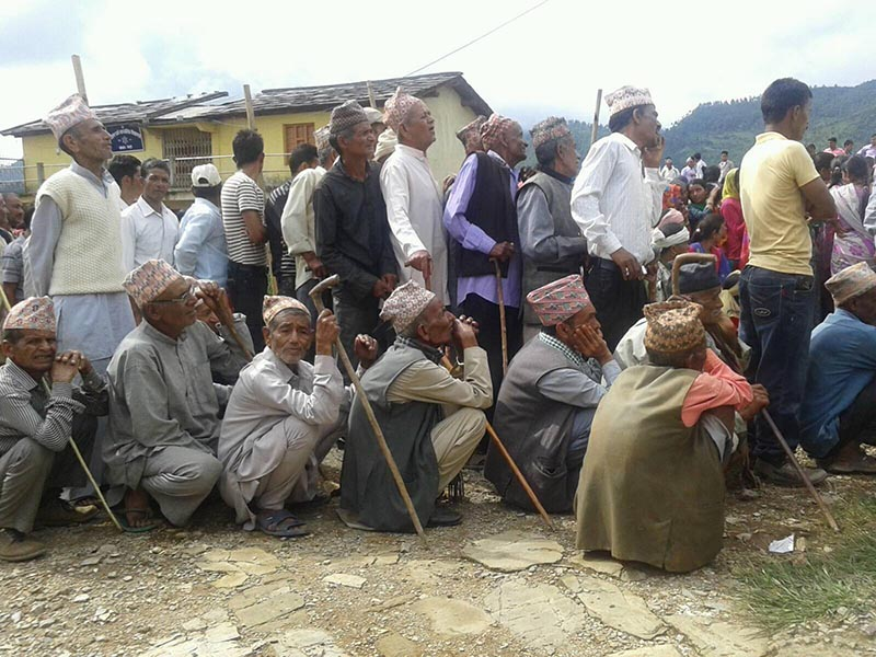 Voters queuing to exercise their franchise at Sanatan Dharma Secondary School-based polling centre at Shreekot of Dogadakedar Rural Municipality in Baitadi district on Wednesday, June 28, 2017. Photo: RSS