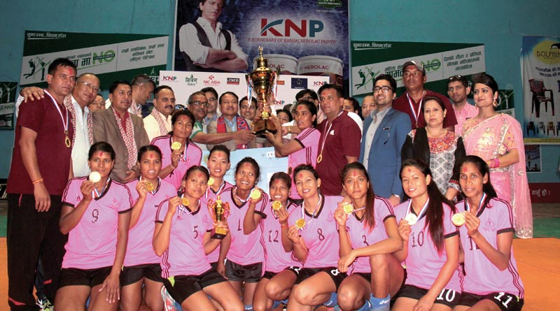 Nepal APF Club team members celebrate with the trophy after winning the KNP National Womenu0092s Club Volleyball Championship in Kathmandu on Friday. Photo: THT