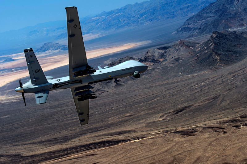 An MQ-9 Reaper remotely piloted drone aircraft performs aerial maneuvers over Creech Air Force Base, Nevada, US, on June 25, 2015. Photo: US Air Force/Senior Airman Cory D. Payne/Handout via Reuters