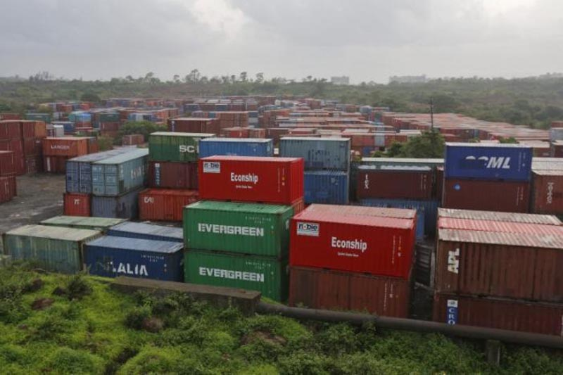 Cargo containers are seen stacked outside the container terminal of Jawaharlal Nehru Port Trust (JNPT) in Mumbai, India, on July 15, 2015. Photo: Reuters/ File