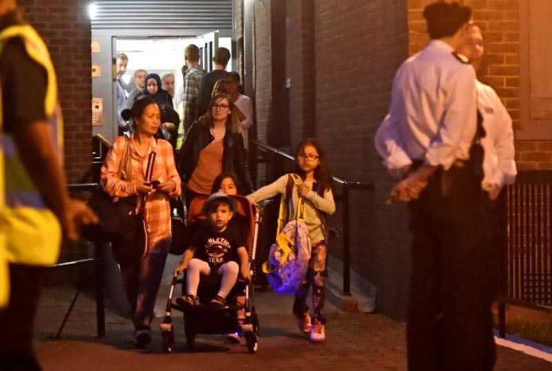 Residents are evacuated from the Taplow Tower residential block as a precautionary measure following concerns over the type of cladding used on the outside of the building on the Chalcots Estate in north London, Britain, on June 23, 2017. Photo: Reuters