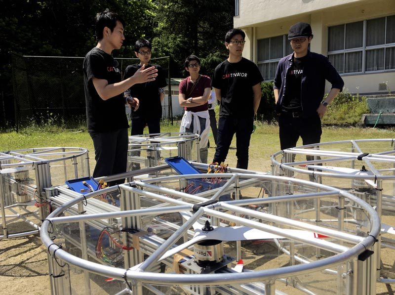 Cartivator members prepare for a test flight of their flying car model on a former school ground in Toyota, central Japan, Saturday, June 3, 2017. Photo: AP