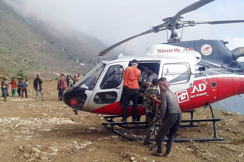 A helicopter being used to transport a pregnant woman to Nepalijung, at rural village in Bajura district, on Sunday, June 25, 2017. Photo: RSS