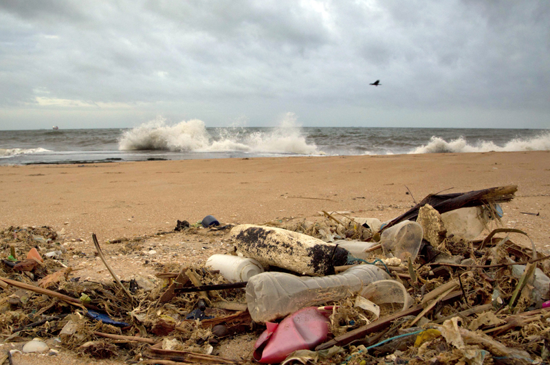 FILE- In this August 13, 2015, file photo, a plastic bottle lies among other debris washed ashore on the Indian Ocean beach in Uswetakeiyawa, north of Colombo, Sri Lanka. Photo: AP