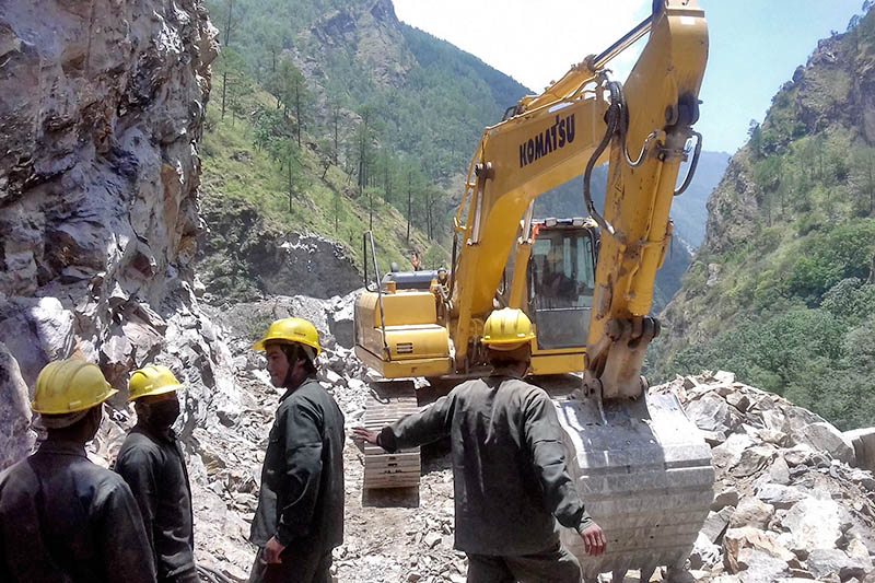 An excavator being used to open track along the Mailung-Safrubeshi in Dhading district, on Friday, June 23, 2017. Photo: RSS