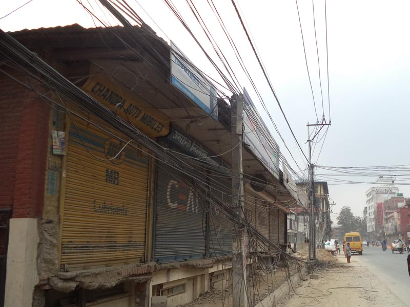 Tripureswor-Nagdhunga road widening project moving at a slow pace as the structures to be demolished for the project are standing tall. Photo: RSS