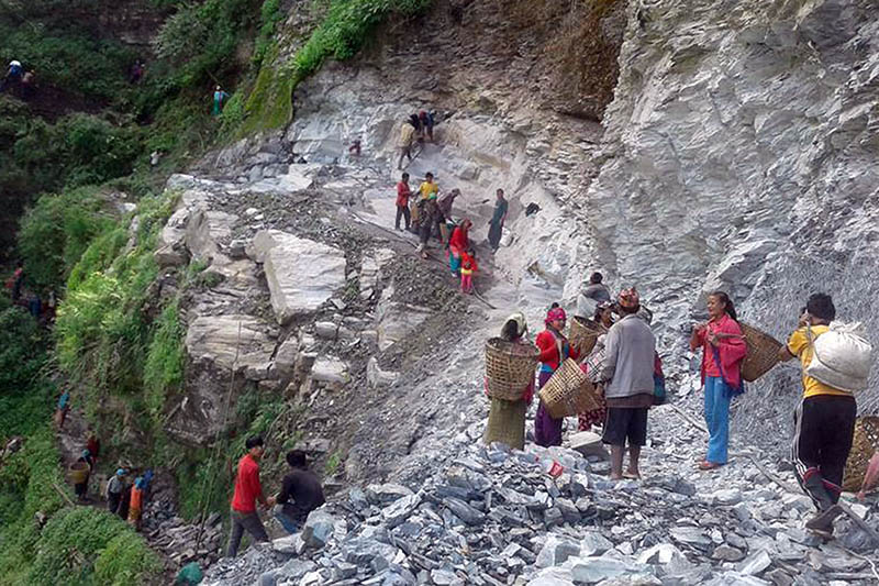 Locals are seen actively participating in a road construction in Raguganga Rural Municipality-4 in Myagdi district, on Monday, June 19, 2017. Photo: RSS