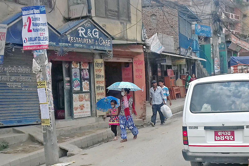 Pedestrians compelled to walk on the road due to lack of pavement along the Kalanki-Kalimati road section, in Kalanki, Kathmandu, on Tuesday, June 27, 2017. Photo: RSS