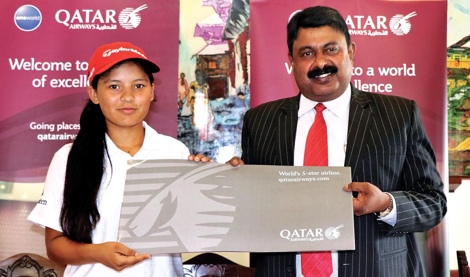 Country Manager of Qatar Airways Jayprakash Nair handing over air tickets to golfer Pratima Sherpa during a press meet at the Royal Nepal Golf Club in Kathmandu, on Tuesday. Photo: THT