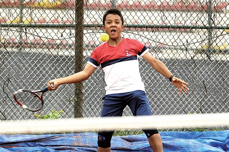 Aadit Subedi returns to Nishan Shrestha during their U-14 boysu2019 singles match of the first ANLTA-JTI Junior National Lawn-Tennis Tournament in Lalitpur, on Sunday. Photo: Naresh Shrestha/ THT