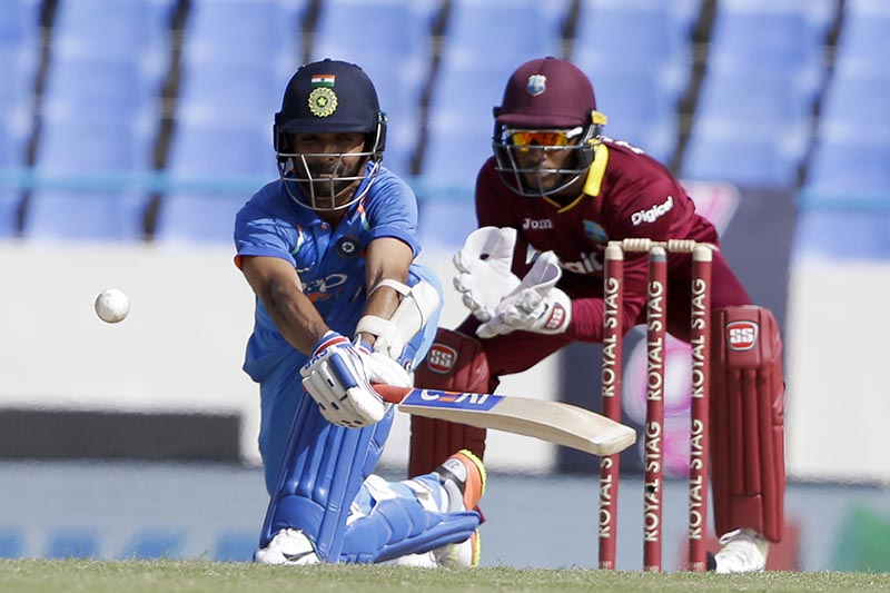 India's Ajinka Rahane plays a shot to be caught by West Indies' wicket keeper Shai Hope during their fourth ODI cricket match at the Sir Vivian Richards Stadium in North Sound, Antigua and Barbuda, Sunday, July 2, 2017. Photo: AP