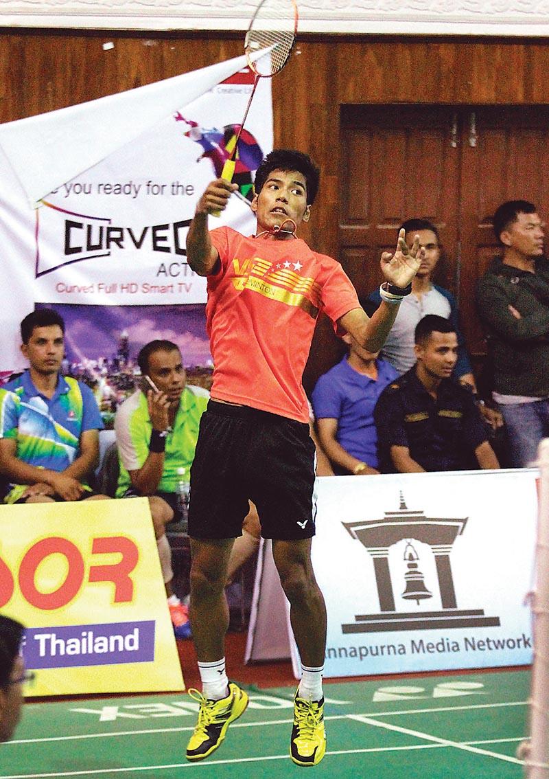 Ratnajit Tamang of TAC returns to Anjan Buragain of India during the menu2019s singles semi-final match of the Annapurna International Corporate Badminton Tournament in Kathmandu on Tuesday. Photo: THT