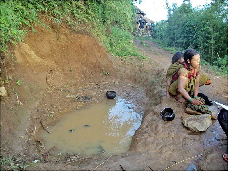 A woman from a Chepang community is seen washing clothes with collected rain water at Brushbang in Dhading district, on Monday, July 3, 2017. Photo: RSS