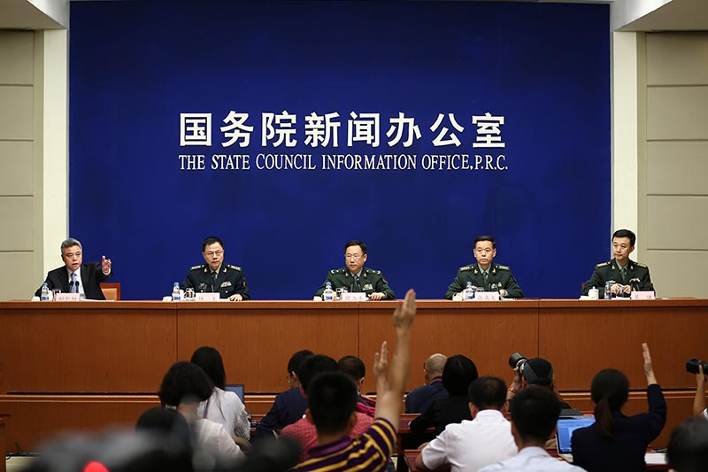 China's Defence Ministry spokesman Wuqian (right) and Central Military Commission officers including Senior Colonel Lu Yu (2nd left), Zhang Chengwen (2nd right) and Major General Zhou Shangping (centre), attend a news conference in Beijing, China, on July 24, 2017. Photo: China Daily via Reuters