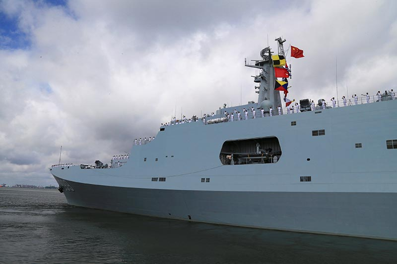 Soldiers of China's People's Liberation Army (PLA) salute from a ship sailing off from a military port in Zhanjiang, Guangdong province, on July 11, 2017. Photo: Reuters