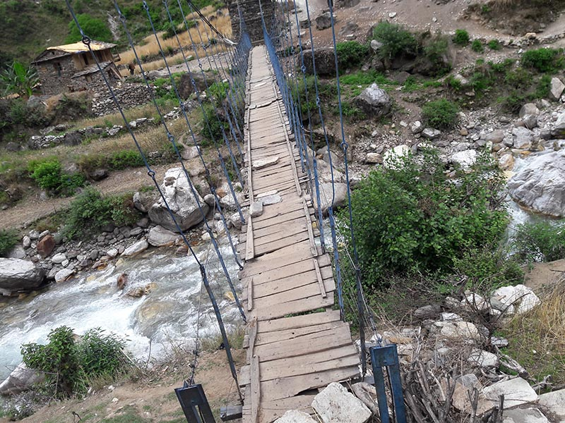 A dilapidated suspension bridge over the Devsain River, in Bichhaya, Bajura, on Thursday, July 13, 2017. The bridge was constructed three decades ago. Photo: THT