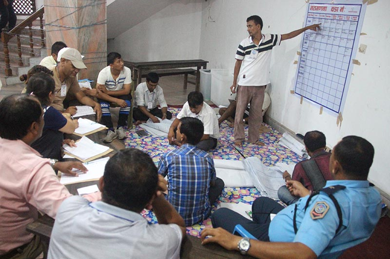 Election officials and party representatives at a vote counting centre, in Dharan Sub-metropolis, Sunsari, on Thursday, July 6, 2017. Photo: THT