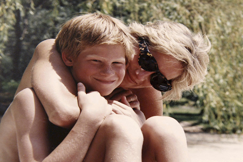 In this photo made available by Kensington Palace from the personal photo album of the late Diana, Princess of Wales, shows the princess and Prince Harry on holiday. Photo: AP