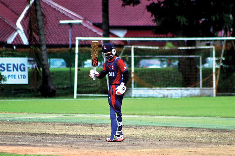 Nepalu2019s Dipendra Singh Airee celebrates after scoring a half century against Singapore during their ICC U-19 World Cup Qualifiers for Asia Region match in Singapore on Friday. Photo Courtesy: Raman Shiwakoti