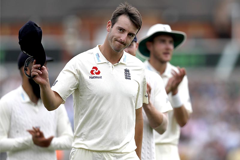 England's Toby Roland-Jones holds up his hat to applause as he leaves the pitch after taking the wicket of South Africa's Temba Bavuma on the third day of the third test match between England and South Africa at The Oval cricket ground in London, on Saturday, July 29, 2017. Photo:AP