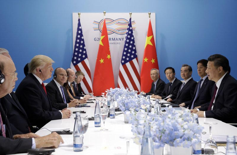 President Donald Trump, second left, meets Chinese President Xi Jinping, right, at the G20 Summit, in Hamburg, Germany, on  Saturday, July 8, 2017. Photo: AP