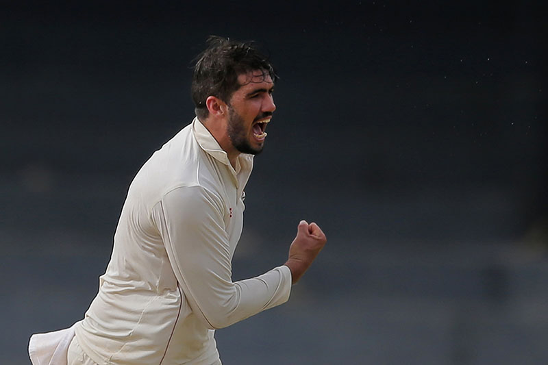 Zimbabwe's captain Graeme Cremer celebrates the dismissal of Sri Lanka's Niroshan Dickwella during the second day's play of their one-off cricket test match in Colombo, Sri Lanka, Saturday, July 15, 2017. Photo: AP