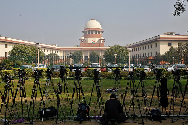 A television journalist sets his camera inside the premises of the Supreme Court in New Delhi, India, on February 18, 2014. Photo: Reuters/File