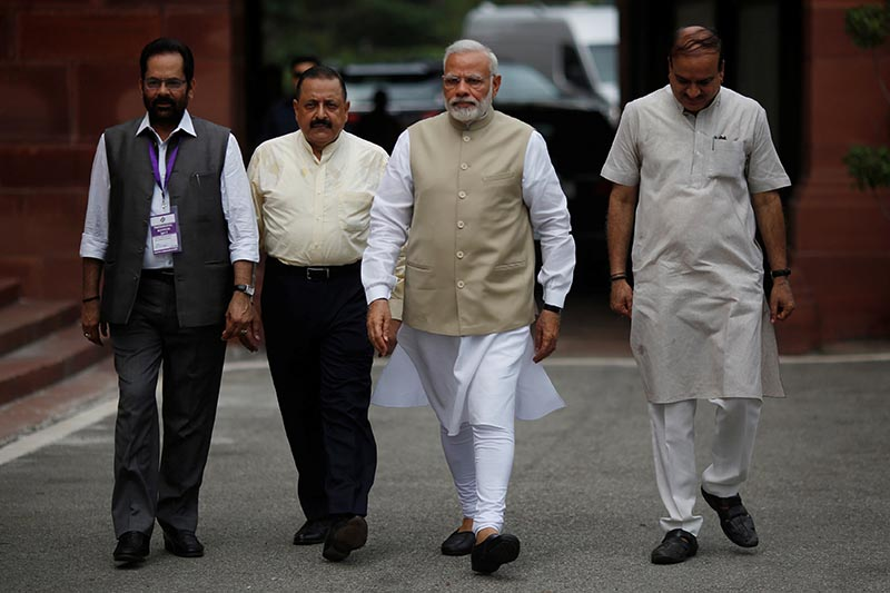 Indiau2019s Prime Minister Narendra Modi (2nd right) arrives to cast his vote for the ceremonial post of president at the Parliament House in New Delhi, India, on July 17, 2017. Photo: Reuters