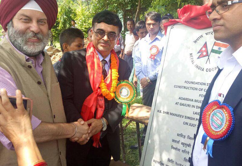 Indian Ambassador to Nepal Manjeev Singh Puri being greeted after laying the foundation stone of Adarsh Multiple Campus, in Gajuri Bazaar, Dhading, on Friday, July 14, 2017. Photo: THT