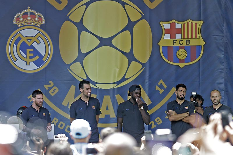 FC Barcelona soccer player, (from left), Lionel Messi, Sergio Busquets, Samuel Umtiti, Luis Suarez, and Andres Iniesta, make an appearance for the fans at Casa Clasico, in Bayside Park in Miami, on Friday, July 28, 2017. Photo: AP