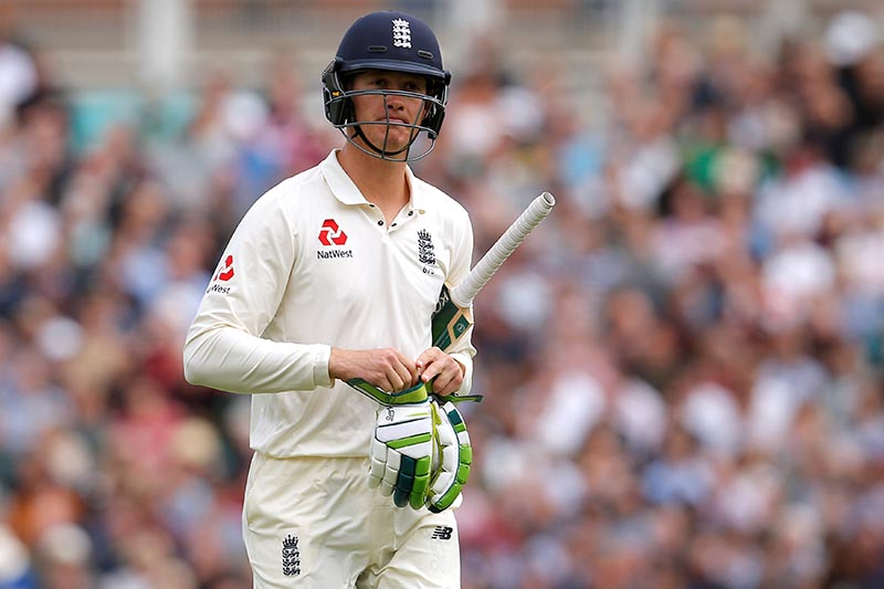 England's Keaton Jennings walks off after being dismissed. Photo: Reuters